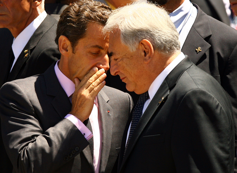 L'AQUILA, ITALY - JULY 09: French President Nicolas Sarkozy (L) chats to Dominique Strauss-Kahn, the Head of the IMF, prior to make his way to the stage where the leaders of the G8 nations and the G5 nations will pose for a 'family photo' on the second day of the G8 summit on July 9, 2009 in L'Aquila, Italy. The talks are being held close to the site of a devastating earthquake in April of this year. The leaders are expected to discuss: climate change, global security and the global recession. (Photo by Oli Scarff/Getty Images)